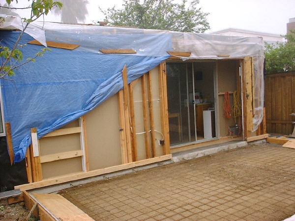 Room addition, 5-30: The ground is ready for the concrete pour. You can see the temporary wall erected inside the now-open doorway, which keeps dust and noise to a minimum.