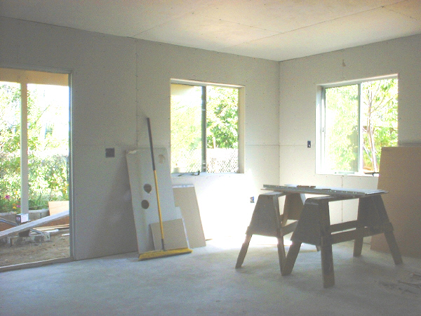 Room addition, 7-16: This photo shows the drywalled interior.