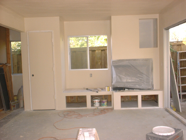 Room addition, 8-13: This photo shows the fireplace wall nearing completion.