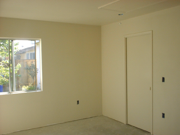 Room addition, 8-21: This photo shows the new sliding door to our master bedroom. You can also see the pull-cord for the attic ladder.