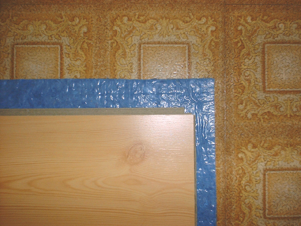Room addition, 9-25: This photo shows the laminate, underlayment, and old linoleum.