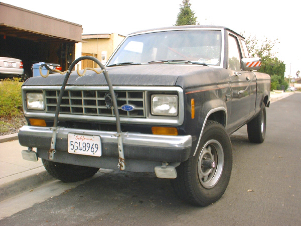 Our ugly '88 Fo'd Ranger XLT, extended cab, 2.9L V-6, automatic overdrive, 4x4, manual hubs, 3-inch factory lift, running B.F. Goodrich 29s.